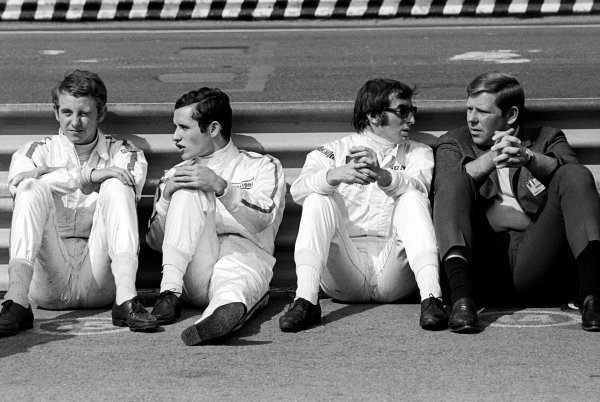 (L to R): Retirees Piers Courage (GBR) BRM and Jacky Ickx (BEL) Ferrari with seventh placed Jackie Stewart (GBR) Matra relax by the guardrail.  Mexican Grand Prix, Mexico City, 3 November 1968.