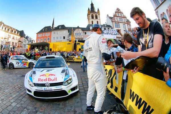 Andreas Mikkelsen (NOR) Volkswagen signs autographs. World Rally Championship, Rd9, ADAC Rally Deutschland, Trier, Germany. Shakedown and Start, Thursday 21 August 2014.