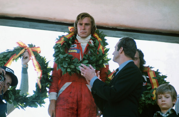 Jarama, Spain. 2nd May 1976.  James Hunt (McLaren M23-Ford), 1st position, with King Carlos of Spain, podium, portrait.  World Copyright: LAT Photographic.  Ref:  76 ESP 03.