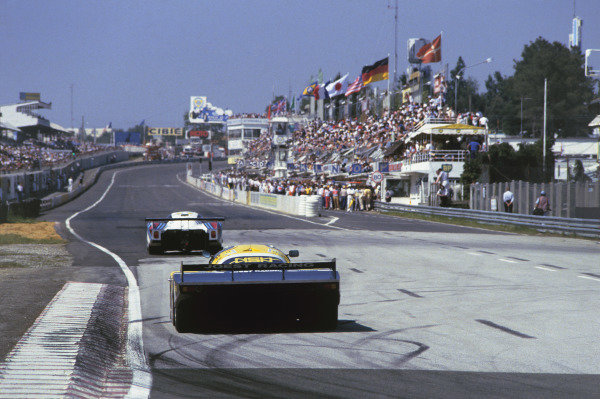 Le Mans, France. 16th -17th  June 1984. Klaus Ludwig/Henri Pescarolo (Porsche 956), 1st position, follows a Lancia down the start/finish straight, action. World Copyright: LAT Photographic.