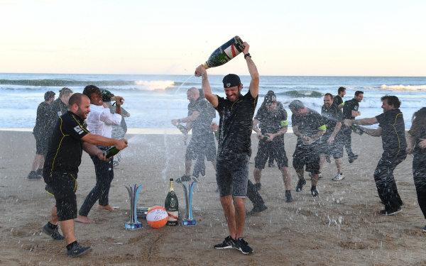 Jean-Eric Vergne (FRA), TECHEETAH, Renault Z.E. 17, sprays the champagne on the beach