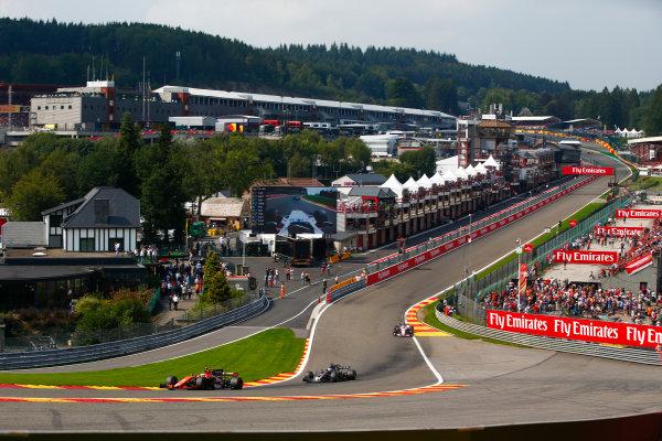 Spa Francorchamps, Belgium.  Sunday 27 August 2017. Stoffel Vandoorne, McLaren MCL32 Honda, leads Romain Grosjean, Haas VF-17, and Sergio Perez, Force India VJM10 Mercedes. World Copyright: Andy Hone/LAT Images  ref: Digital Image _ONZ3492