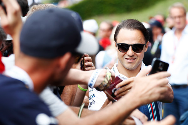 Red Bull Ring, Spielberg, Austria. Saturday 08 July 2017. Felipe Massa, Williams Martini Racing, signs autograps for fans. World Copyright: Glenn Dunbar/LAT Images ref: Digital Image _X4I6202