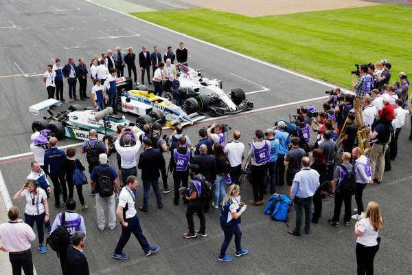 Williams 40 Event Silverstone, Northants, UK Friday 2 June 2017. Sir Frank Williams and Patrick Head pose for media between a Williams FW40 Mercedes, FW11 Honda and FW08. Former drivers line-up behind. L-R Antonio Pizzonia, Martin Brundle, Paul di Resta, Jason Plato, Felipe Massa, Williams Martini Racing, Lance Stroll, Williams Martini Racing.Riccardo Patrese, Nigel Mansell, Keke Rosberg, Damon Hill, Nico Rosberg, David Coulthard, Alex Wurz, Karun Chandhok and Pastor Maldonado. World Copyright: Zak Mauger/LAT Images ref: Digital Image _56I0165