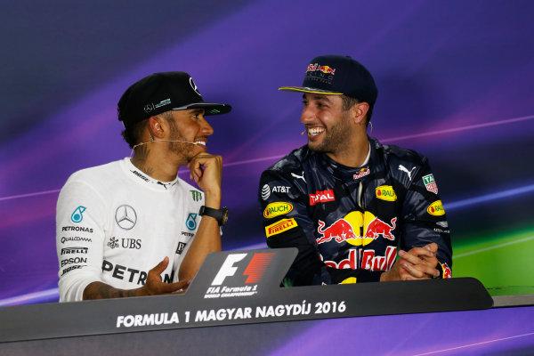 Hungaroring, Budapest, Hungary. Sunday 24 July 2016. Lewis Hamilton, Mercedes AMG, 1st Position, and Daniel Ricciardo, Red Bull Racing, 3rd Position, joke in the Press Conference. World Copyright: Sam Bloxham/LAT Photographic ref: Digital Image _SBB9228