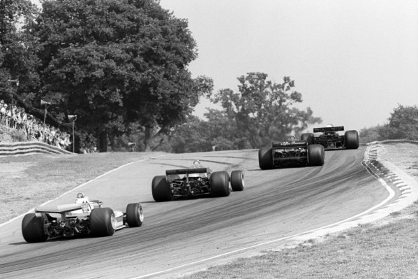 Race winner Carlos Reutemann (ARG) Ferrari 312T3 behind race retiree Riccardo Patrese (ITA) Arrows FA1, second placed Niki Lauda (AUT) Brabham BT46, and race leader Jody Scheckter (RSA) Wolf WR5, who retired from the race on lap 37 with a broken geartbox.British Grand Prix, Rd 10, Brands Hatch, England, 16 July 1978.