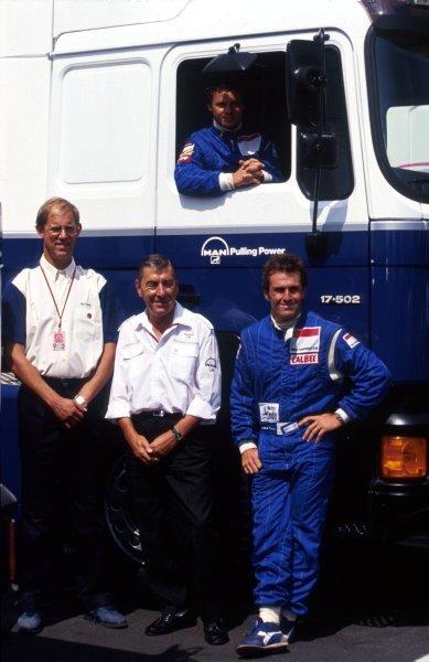 Olivier Grouillard (FRA) Tyrrell (In truck) with (L to R): Bob Tyrrell (GBR) Tyrrell Marketing Director; Jochan Luck; Andrea de Cesaris (ITA) Tyrrell. German Grand Prix, Hockenheim, 26 July 1992.