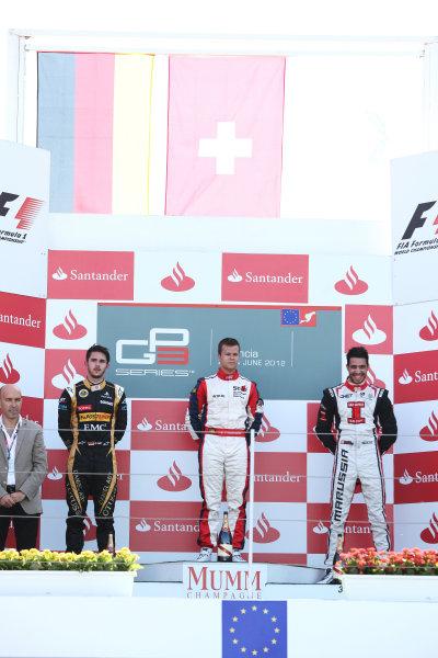 2012 GP3 Series, Round 3.Valencia, Spain. 24th June 2012. Sunday Race 2. (LtoR) 2nd place Daniel Abt (GER, Lotus GP) 1st place Patric Niederhauser (SUI, Jenzer Motorsport) 3rd place Tio Ellinas (CYP, Marussia Manor Racing) on the podium. Portrait. World Copyright:  Daniel Kalisz/LAT Photographic Ref: Digital Image IMG_2099