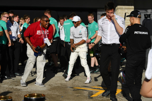 Lewis Hamilton (GBR) Mercedes AMG F1, Toto Wolff (AUT) Mercedes AMG F1 Director of Motorsport and Valtteri Bottas (FIN) Mercedes AMG F1 celebrate with the champagne at Formula One World Championship, Rd17, United States Grand Prix, Race, Circuit of the Americas, Austin, Texas, USA, Sunday 22 October 2017.