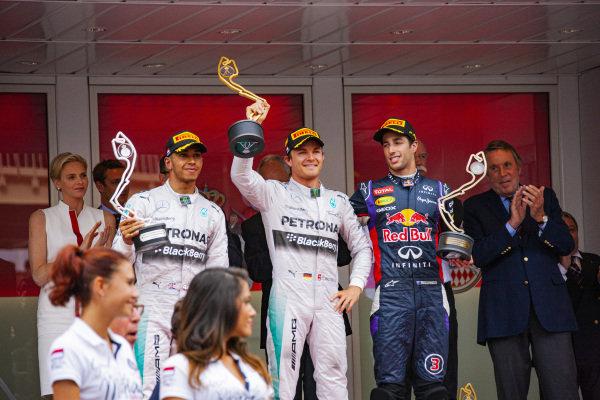 Nico Rosberg, 1st position, Lewis Hamilton, 2nd position, and Daniel Ricciardo, 3rd position, celebrate on the podium.