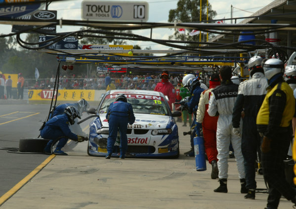 2002 Australian V8 Supercar Championship R9 QLD 500 Queensland, Australia 15th September 2002Kmart Racing crew try to fix the damaged car of Andy Priaulx and Yvan Muller after contact with another car.World Copyright - Mark Horsburgh/LAT Photographicref: Digital File Only