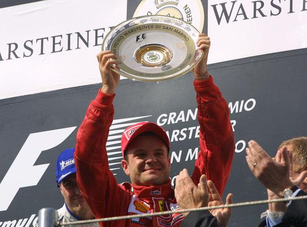 2001 San Marino Grand Prix.Imola, Italy. 13-15 April 2001.Rubens Barrichello (Ferrari) celebrates his 3rd position on the podium.World Copyright - Steve Etherington/LAT Photographicref: 9 mb digital image.