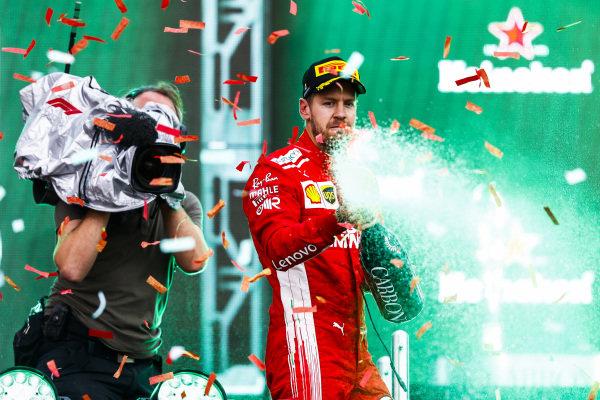 Sebastian Vettel, Ferrari, 2nd position, sprays Champagne on the podium