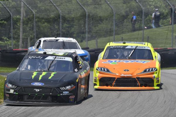 #98: Riley Herbst, Stewart-Haas Racing, Ford Mustang Monster Energy and #19: Brandon Jones, Joe Gibbs Racing, Toyota Supra Menards/Swiffer
