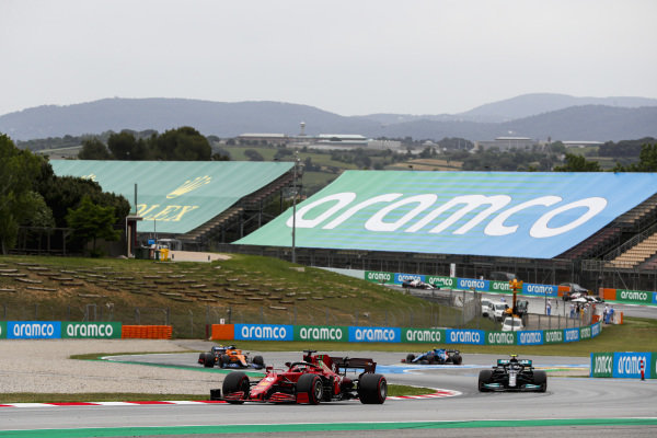 Charles Leclerc, Ferrari SF21, leads Valtteri Bottas, Mercedes W12, Daniel Ricciardo, McLaren MCL35M, and Esteban Ocon, Alpine A521