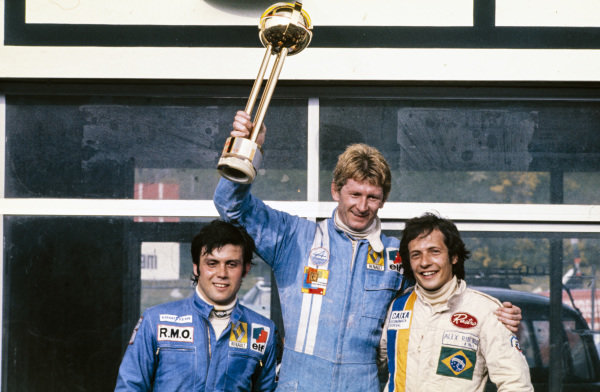 Jean-Pierre Jabouille, 1st position, Patrick Tambay, 2nd position, and Alex Ribeiro, 3rd position, celebrate on the podium.