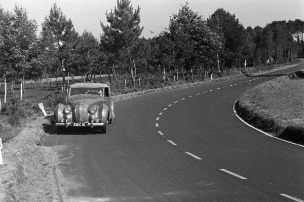 The Aston Martin Lagonda 3 Litre DHC is driven around the circuit.