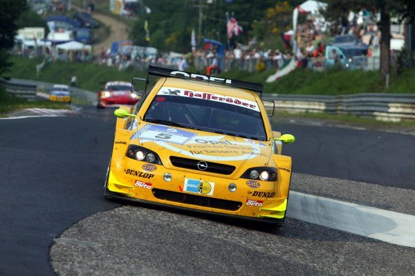 Manuel Reuter (GER) / Timo Scheider (GER) / Marcel Tiemann (GER) / Volker Strycek (GER) OPC Team Phoenix Opel Astra V8 Coupe drop into the Karussel on their way to the win.