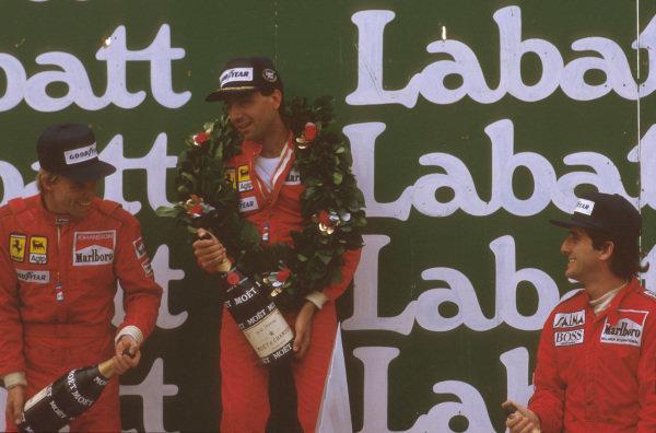 Montreal, Quebec, Canada.14-16 June 1985.Michele Alboreto (Ferrari) 1st position, Stefan Johansson (Ferrari) 2nd position and Alain Prost (McLaren TAG Porsche) 3rd position on the podium.Ref-85 CAN 06.World Copyright - LAT Photographic
