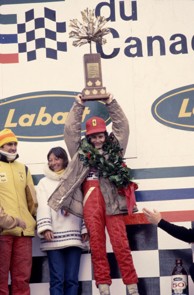 1978 Canadian Grand Prix.Montreal, Quebec, Canada.6-8 October 1978.Gilles Villeneuve (Ferrari) 1st position for his maiden Grand Prix win and teammate Carlos Reutemann, 3rd position on the podium. Gilles wife Joan also stands by his side.Ref-78 CAN 07.World Copyright - LAT Photographic