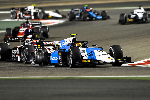 Lirim Zendeli (DEU, MP Motorsport), leads Christian Lundgaard (DNK, ART Grand Prix), with a puncture