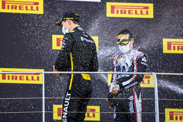 Christian Lundgaard (DNK, ART GRAND PRIX), 1st position, and Juri Vips (EST, DAMS), 3rd position, spray Champagne on the podium