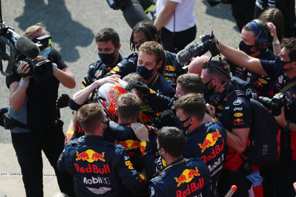 Max Verstappen, Red Bull Racing, celebrates victory with his team in parc ferme