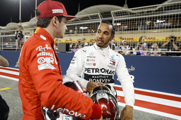 Charles Leclerc, Ferrari celebrates pole position in Parc Ferme with Lewis Hamilton, Mercedes AMG F1