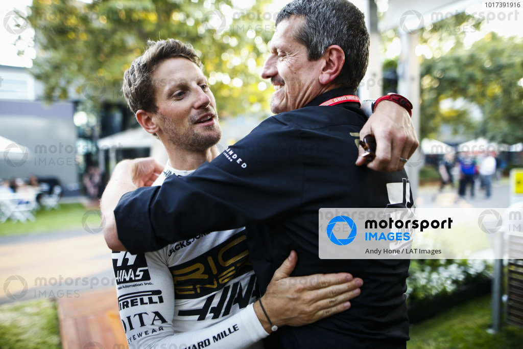 Romain Grosjean, Haas F1, and Guenther Steiner, Team Principal, Haas F1, congratulate each other with a hug