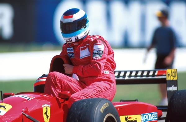 Mika hakkinen gets a lift back to the pits with Gerhard Berger. German GP, Hockenheim, 30 July 1995