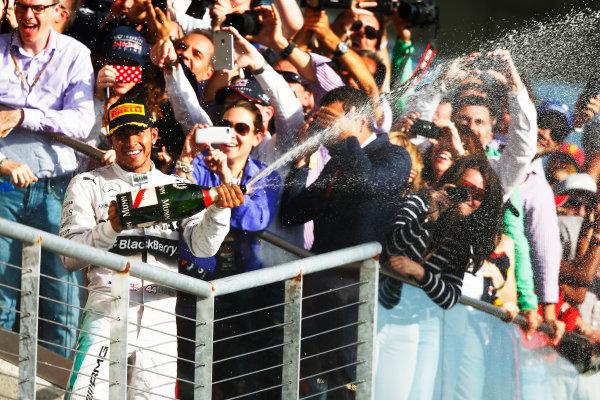 Circuit of the Americas, Austin, Texas, United States of America. Sunday 2 November 2014. Lewis Hamilton, Mercedes AMG, 1st Position, sprays Champagne on the podium. World Copyright: Andrew Hone/LAT Photographic. ref: Digital Image _ONY6400