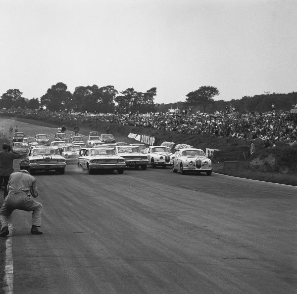 Brands Hatch, England. 5th August 1963. Rd 8. L to R: Jack Sears (Ford Galaxie), retired, Jim Clark (Ford Galaxie), 1st position and Graham Hill (Jaguar Mk II 3.8), 2nd position, lead at the start of the race, action.  World Copyright: LAT Photographic. Ref:  20791.