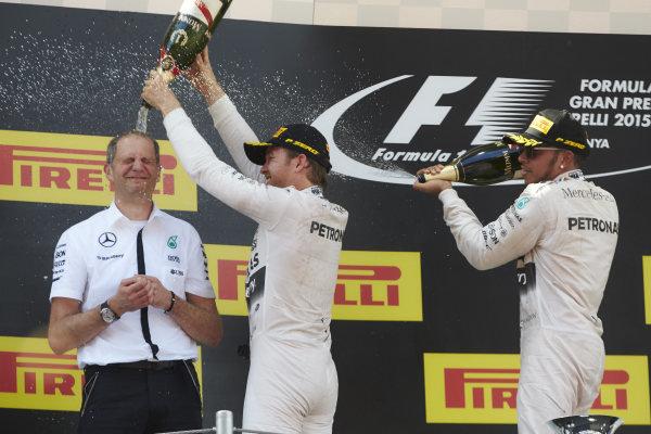 Circuit de Catalunya, Barcelona, Spain. Sunday 10 May 2015. Nico Rosberg, Mercedes AMG and Lewis Hamilton, Mercedes AMG spray the champagne onto Tony Ross, Race Engineer, Mercedes AMG on the podium. World Copyright: Steve Etherington/LAT Photographic. ref: Digital Image SNE29642