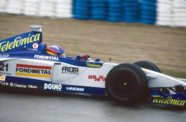 1999 Formula 1 Testing. Jerez, Spain. 13th - 17th December 1999. Fernando Alonso, Minardi M01, action. World - Gavin Lawrence/LAT Photographic. Ref: 35mm Colour Transparency.
