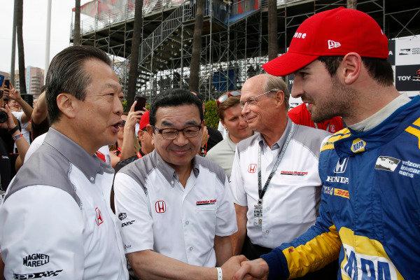 Toshiaki Mikoshiba, President and CEO of American Honda Motor Company, Inc., and Takahiro Hachigo, President of Honda Motor Company congratulate Alexander Rossi, Andretti Autosport Honda