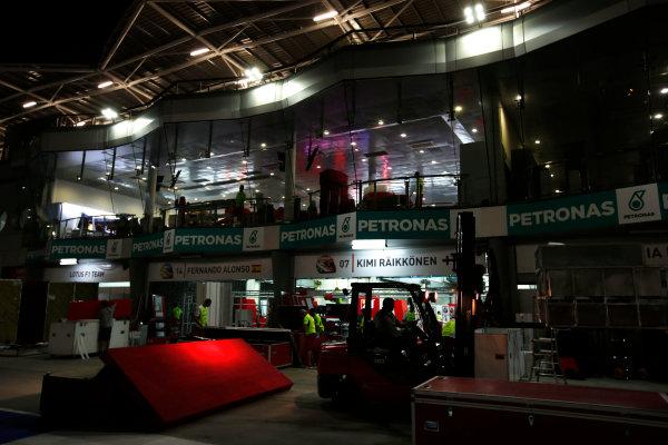 Sepang International Circuit, Sepang, Kuala Lumpur, Malaysia. Sunday 30 March 2014. The Ferrari garage in process of being dismantled. World Copyright: Charles Coates/LAT Photographic. ref: Digital Image _N7T8952