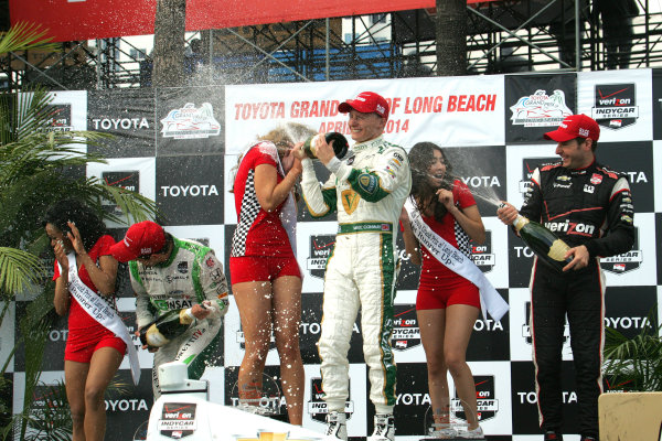 11-13 April, 2014, Long Beach, California USA Carlos Munoz, Mike Conway, and Will Power celebrate with champagne ©2014, Leland Hill LAT Photo USA