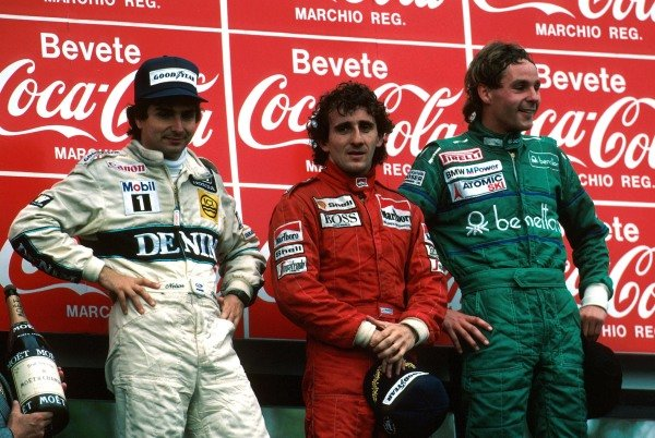 Winner Alain Prost (FRA), 2nd place Nelson Piquet (BRA) and 3rd place Gerhard Berger (AUS) celebrate on the podiumSan Marino GP, Imola, Italy, 24 April 1986