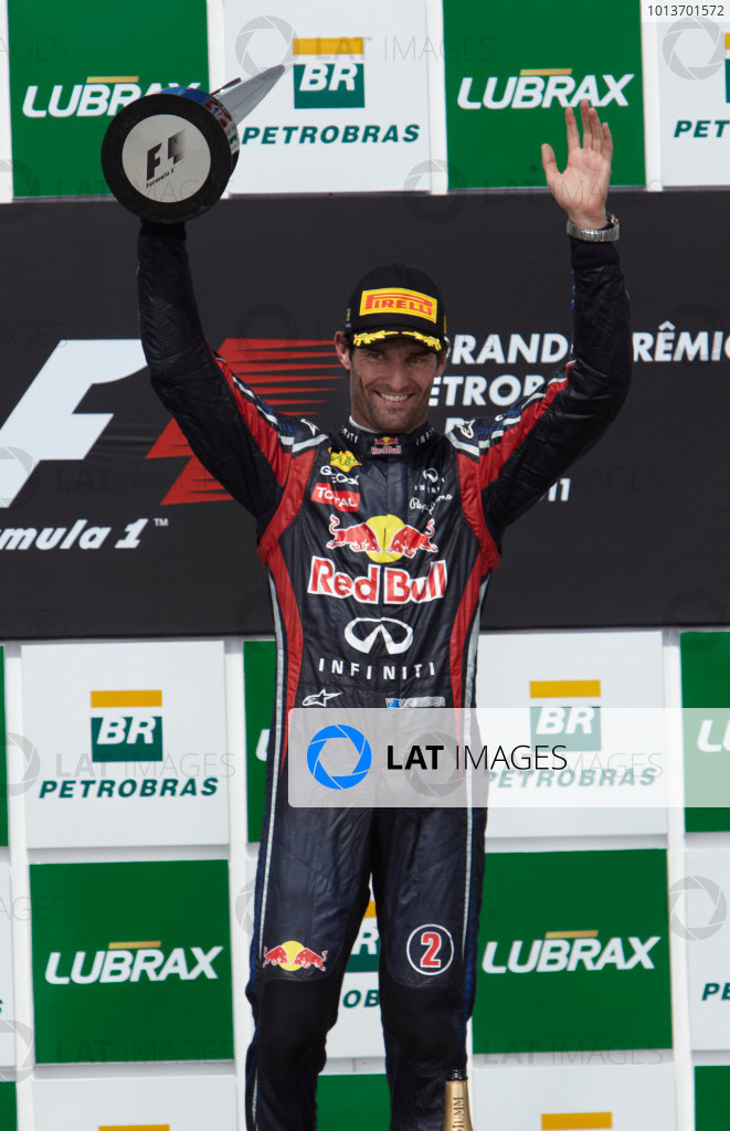 Interlagos, Sao Paulo, Brazil. 27th November 2011. Mark Webber, Red Bull Racing RB7 Renault, 1st position, celebrates victory. Portrait. Podium.  World Copyright: Steve Etherington/LAT Photographic ref: Digital Image SNE28319