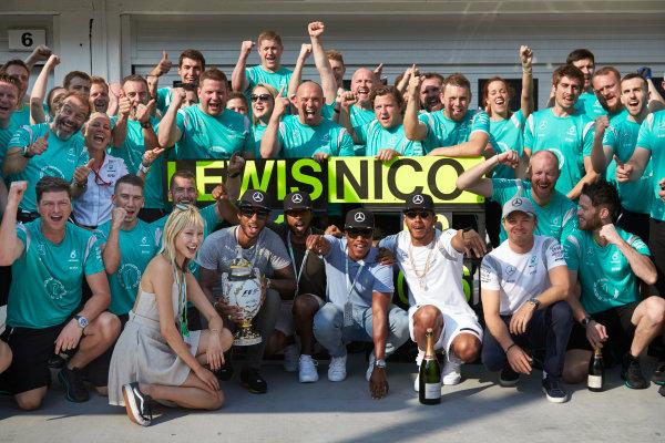 Hungaroring, Budapest, Hungary. Sunday 24 July 2016. Lewis Hamilton and Nico Rosberg celebrate with the Mercedes AMG team after the race. World Copyright: Steve Etherington/LAT Photographic ref: Digital Image SNE10780