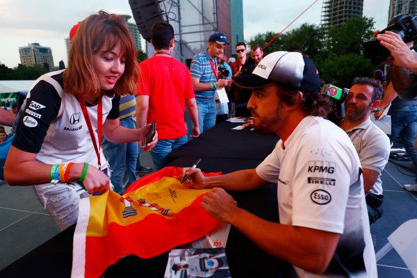 Baku City Circuit, Baku, Azerbaijan. Saturday 18 June 2016. Fernando Alonso, McLaren, signs autographs for fans. World Copyright: Steven Tee/LAT Photographic ref: Digital Image _H7I9953
