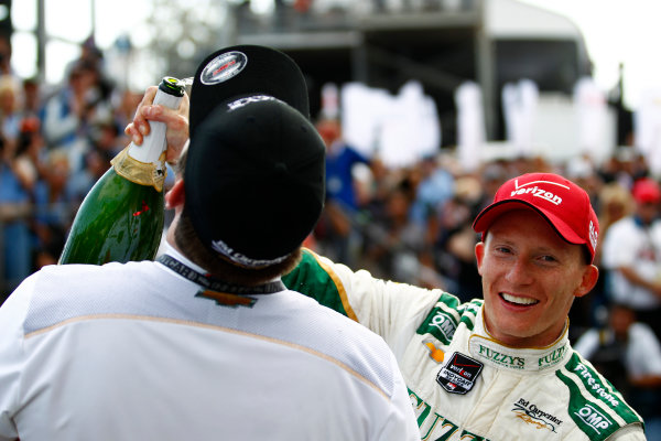 11-13 April, 2014, Long Beach, California USA Mike Conway celebrates with champagne in victory lane ©2014, Phillip Abbott LAT Photo USA