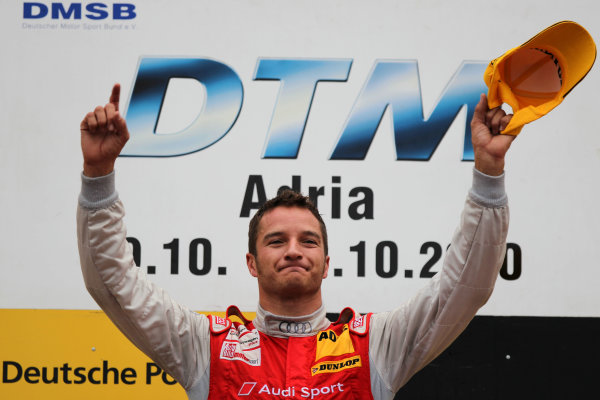 Race winner Timo Scheider (GER), Audi Sport Team Abt celebrates on the podium.DTM, Rd10, Adria International Raceway, Italy. 29-31 October 2010 World Copyright: LAT Photographicref: dne1031oc126