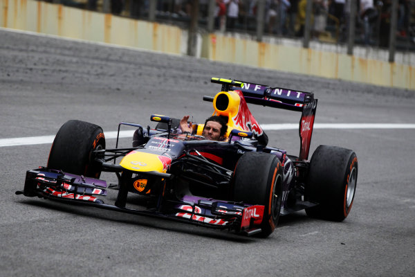 Interlagos, Sao Paulo, Brazil. Sunday 24rd November 2013.  Mark Webber, Red Bull RB9 Renault, 2nd position, tours minus his helmet after completing his last race in F1. World Copyright: Andy Hone/LAT Photographic. ref: Digital Image _ONY0939