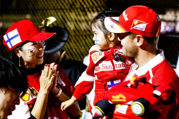 Suzuka Circuit, Japan. Saturday 7 October 2017. Sebastian Vettel, Ferrari, meets a fan. World Copyright: Steven Tee/LAT Images  ref: Digital Image _O3I8781