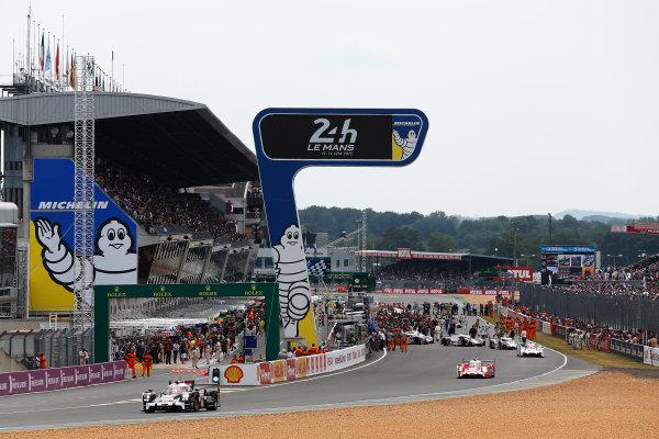 2015 Le Mans 24 Hours. Circuit de la Sarthe, Le Mans, France. Saturday 13 June 2015. Porsche Team (Porsche 919 Hybrid - LMP1), Romain Dumas, Neel Jani, Marc Lieb, leaves the grid Photo:  Sam Bloxham/LAT Photographic. ref: Digital Image _SBL9585