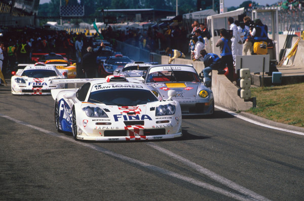 1997 Le Mans 24 hours. Le Mans, France. 14th - 15th June 1997. Roberto Ravaglia / Eric Helary / Peter Kox (McLaren F1 GTR), 3rd overall and 2nd in Class, leave the pit lane, action. World Copyright: LAT Photographic.