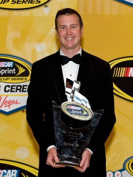 1-4 December, 2009, Las Vegas, Nevada, USAKurt Busch with trophy©2009, Michael L. Levitt, USALAT Photographic