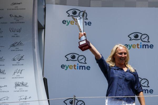 RUSSIAN TIME Team Principal, Svetlana Strelnikova, collects the trophy.