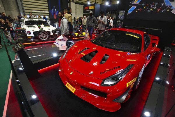 A Ferrari and Bentley on the Pirelli stand.